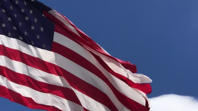 USA American Flag Flying in Western Colorado Early Spring Outdoors Wind Blown USA American Flag Flying in Western Colorado Early Spring Outdoors Series in Various Stages (4K Video Rendered in DaVinci Resolve) fourth of july videos stock videos & royalty-free footage