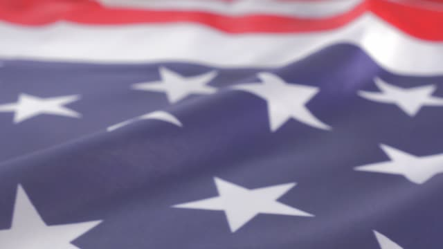 american flag soft focus dolly sliding close-up 4k 2160p uhd video - usa flag stars and bars slow sliding with dolly 4k 3840x2160 uhd footage - holiday background filmów i materiałów b-roll