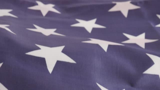 American flag stripes and stars tilting 4K American flag stripes and stars tilting 4K 3840X2160 UltraHD footage - Tilt over USA flag  4K 2160p UHD video american flag videos stock videos & royalty-free footage