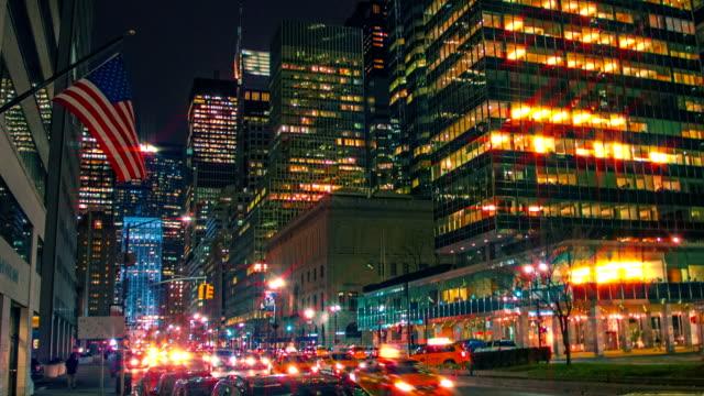 American flag, traffic on a city street, New York video