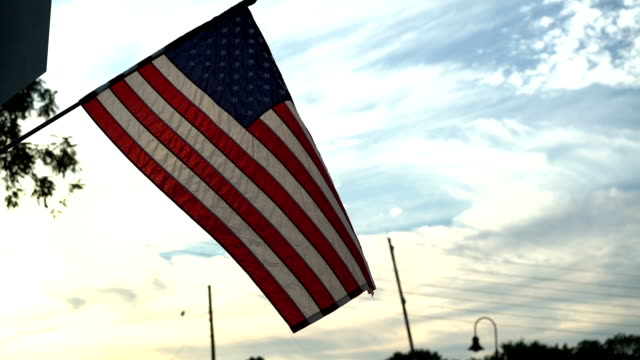 American Flag Waving at Sunset in a Small Town (60 FPS) American flag waving at sunset in a small town. americana stock videos & royalty-free footage