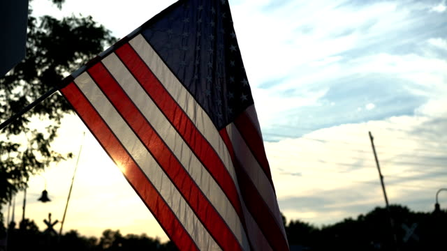 American Flag Waving at Sunset in a Small Town (60 FPS) video