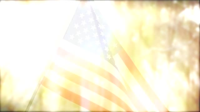 American flag waving in the breeze. American flag fades in or out against a sunset background. memorial day stock videos & royalty-free footage