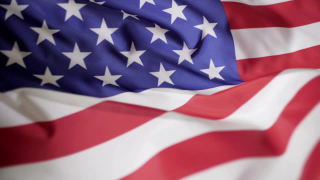 American flag waving in the wind, slow motion American flag waving in the wind, slow motion. memorial day stock videos & royalty-free footage
