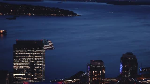 American Flag Waving on City Building Aerial