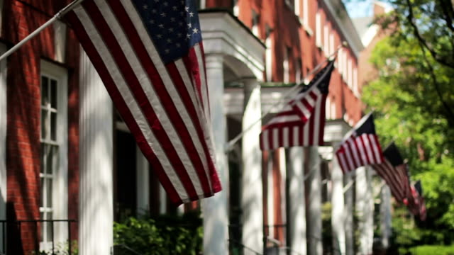 American Flags on Homes A row of traditional American flags on colonial homes. fourth of july videos stock videos & royalty-free footage