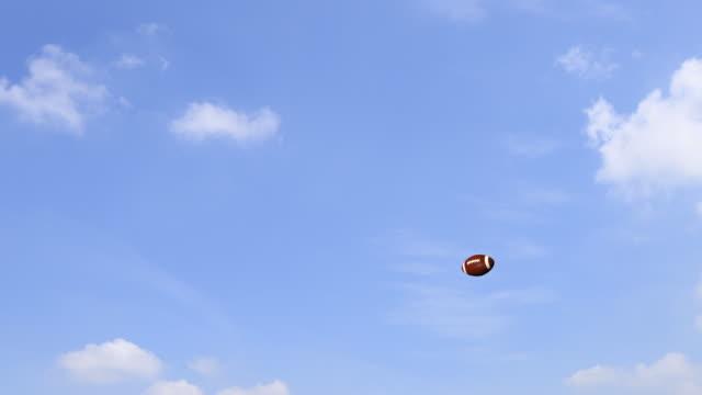 american football ball in blue sky