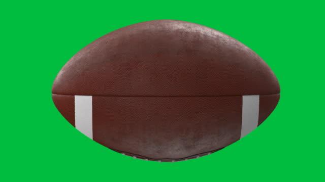 american football ball on green screen background