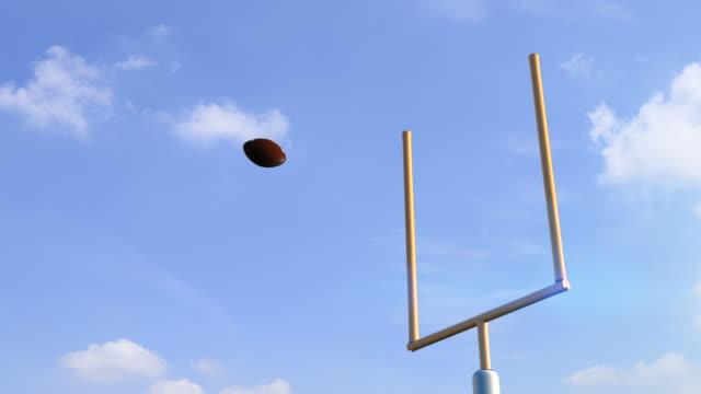 american football ball through goal post