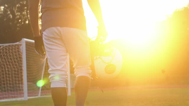 American Football Player At Sports Stadium (in Silhouette)