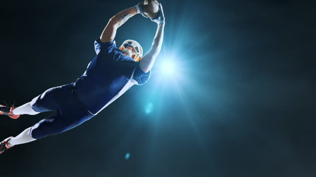 American football player jumps with a ball American football player jumps with a ball on on abstract background with floodlight and intensional lense-flares. He is wearing unbranded sports clothes. touchdown stock videos & royalty-free footage