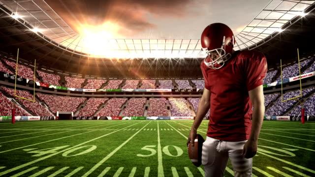 american football player patrzeć w dół - trykot filmów i materiałów b-roll