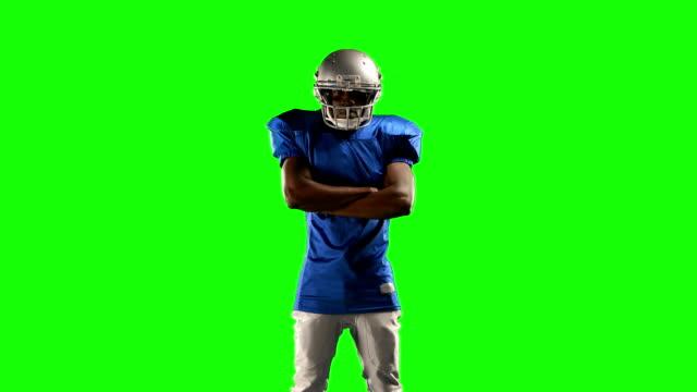 zawodnik futbolu amerykańskiego na zielony ekran - trykot filmów i materiałów b-roll
