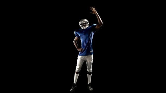 american football player gra - trykot filmów i materiałów b-roll