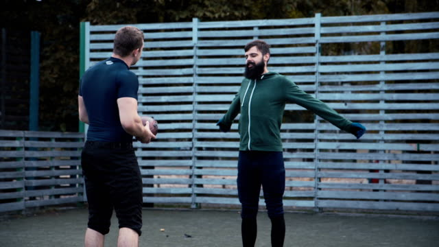 American football players warming up at training video