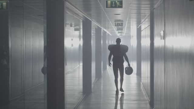 American Football Silhouette in Sports Stadium