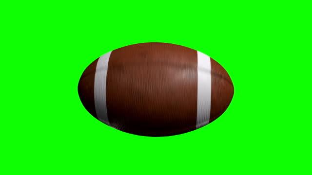 vidéos et rushes de football américain sur écran vert de spinning - balle ou ballon