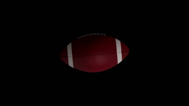 American footballl rotating loop isolated with luma matte video