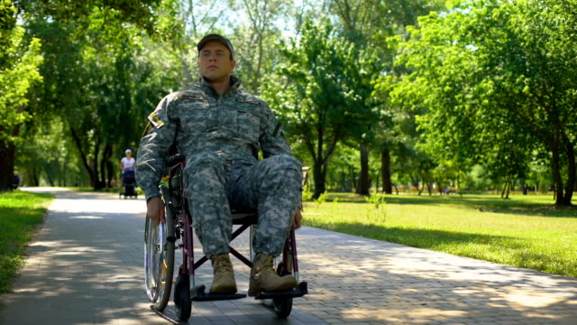 American military veteran moving on wheelchair in city park, health care program American military veteran moving on wheelchair in city park, health care program veteran stock videos & royalty-free footage