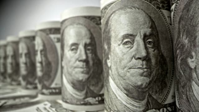 american one hundred dollar paper banknote in close up macro view dolly shot. - conto corrente video stock e b–roll