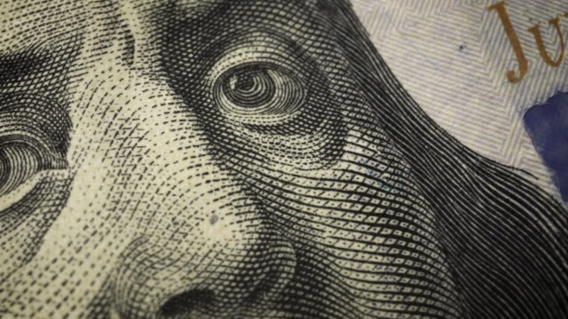 American one hundred dollar paper banknote in close up macro view dolly shot. American one hundred dollar paper banknote in close up macro view dolly shot. Concept of finance and economy. paper currency stock videos & royalty-free footage
