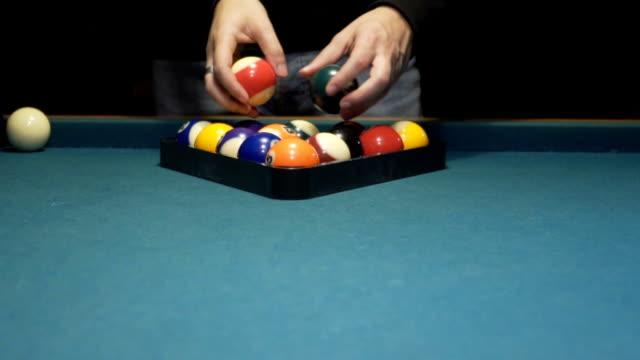 american pool, creating billiard pyramid. 120fps - campionato video stock e b–roll