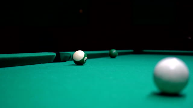 American pool, swimming pool for nine balls. The girl plays billiards, snooker
