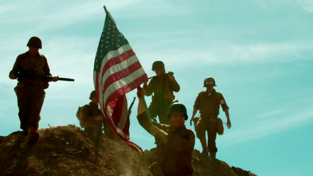 American Soldiers Taking Flag up Hill