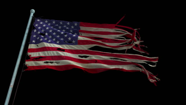American torn and tattered flag waves in the wind. Looped, with alpha channel torn stock videos & royalty-free footage