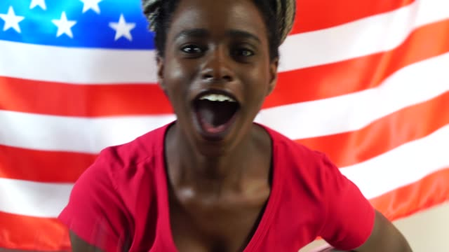 American Young Black Woman Celebrating with USA Flag video