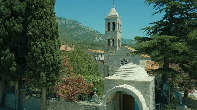 Among trees of mountains is a church of white stone video