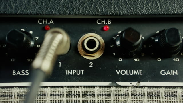 Amplifier for electric guitar in a music studio