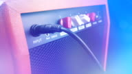 istock Amplifier In Colorful Lights With Lens Flares 1212228184