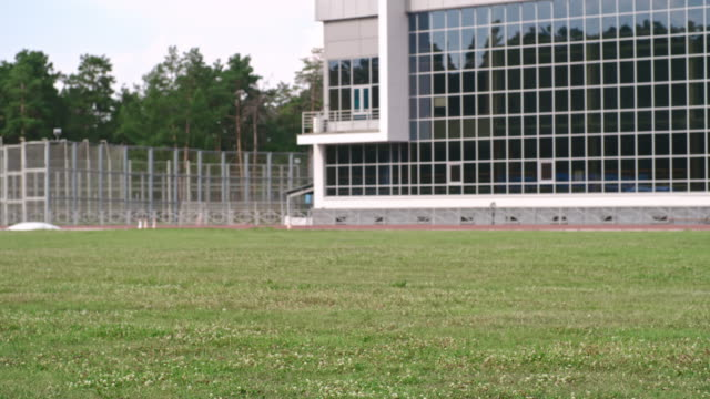 Amputee athlete practicing power walking Tracking shot of barefoot amputee runner with prosthetic leg practicing speed walking exercise on grass at outdoor stadium artificial limb stock videos & royalty-free footage