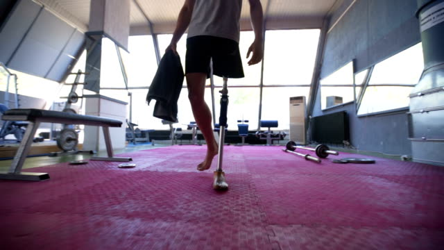 Amputee athlete walking Amputee athlete with artificial leg, living the healthy lifestyle, exercising in the gym. amputee stock videos & royalty-free footage