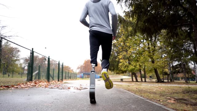 Amputee athlete with a artificial leg living a healthy lifestyle Young and athletic man with a artificial leg, exercising outdoors, living a healthy lifestyle recovering. artificial limb stock videos & royalty-free footage