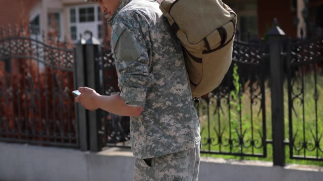 Amputee Soldier Text Messaging To His Family On His Way Home Handsome Young Amputee Soldier Coming Home  From Serving Military, Using Phone To Send Messages To His Family veteran stock videos & royalty-free footage