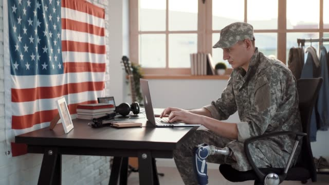 Amputee Soldier Working at Office Amputee Army Soldier Working At Office military uniform stock videos & royalty-free footage