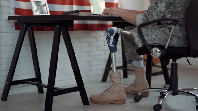 Amputee Soldier Working at Office Amputee Army Soldier Working At Office fourth of july videos stock videos & royalty-free footage