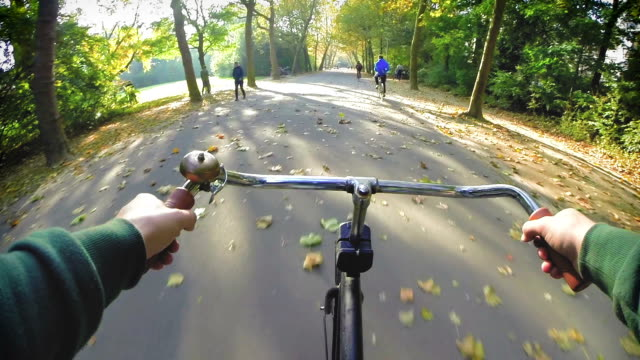 Amsterdam by Bike - Park Ride A point of view bike ride through the centrally located Vondel Park in the beautiful and historic center of Amsterdam. dutch architecture stock videos & royalty-free footage