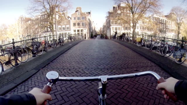 amsterdam in bicicletta - amsterdam video stock e b–roll