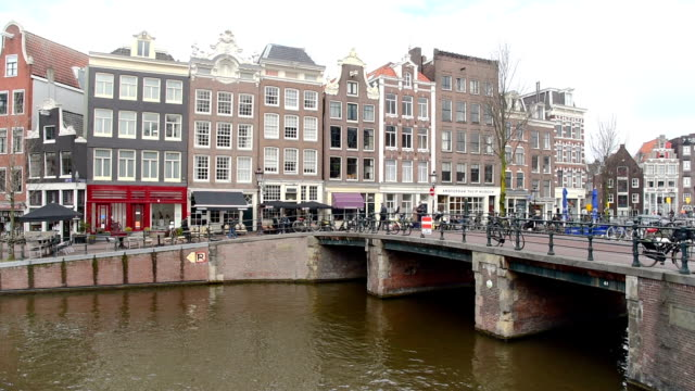 Amsterdam canal, bicycles and cyclists, houseboats, living boats. video