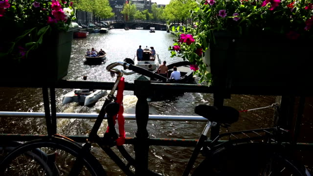 Amsterdam canal with bicycle and ships video