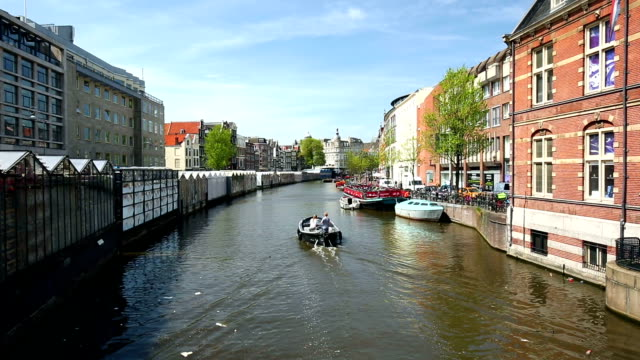 Amsterdam canal with floating market video