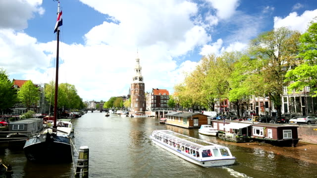 Amsterdam canal  with hosueboats and ships video