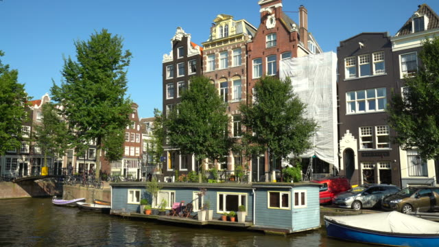 Amsterdam canal with houseboats video
