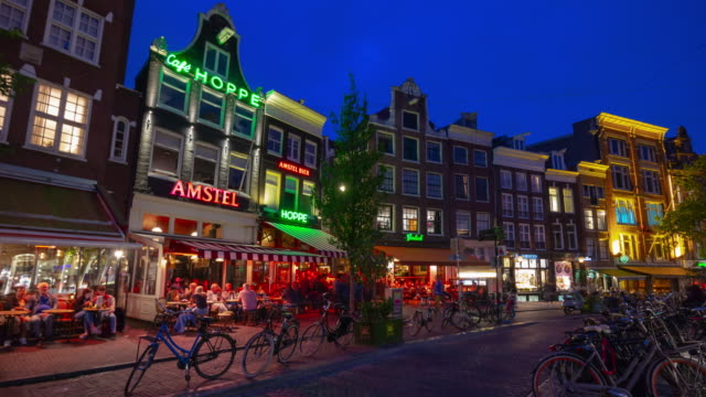 amsterdam city night life illuminated traffic street famous cafe panorama 4k timelapse netherlands - amsterdam video stock e b–roll