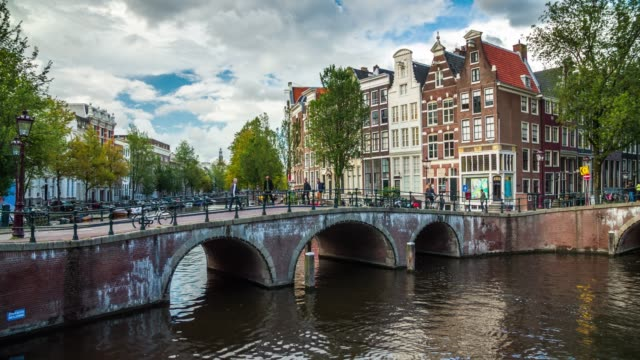 amsterdam cityscape with canal and bridge - amsterdam video stock e b–roll