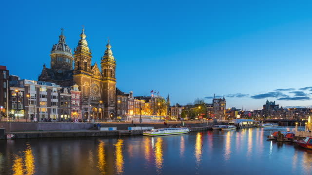 Amsterdam cityscape with view of canal and church 4K night time lapse Amsterdam cityscape with view of canal and church 4K night time lapse. amsterdam stock videos & royalty-free footage