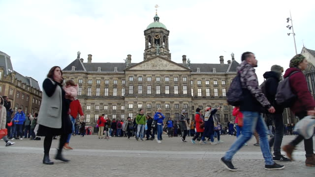 Amsterdam Dam Square and royal palace  tourists walk on the street video